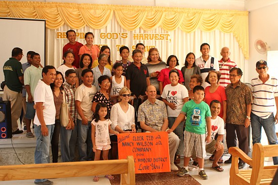 Members of the local Adventist church in Mamburao, Occidental Mindoro Philippines, gather around Pastor Ted Wilson and wife, Nancy for a picture during the Wilsons' brief visit to the island on May 6. Wilson came to the Philippines to preach in an evangelistic series for Hope Manila 2014, a church initiative that focuses in the metropolitan area of the country.